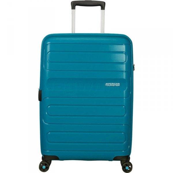 Bagaż Sunside 77 cm ciemny turkus. Bagaż posiada cztery obrotowe koła oraz zamek szyfrowy TSA
