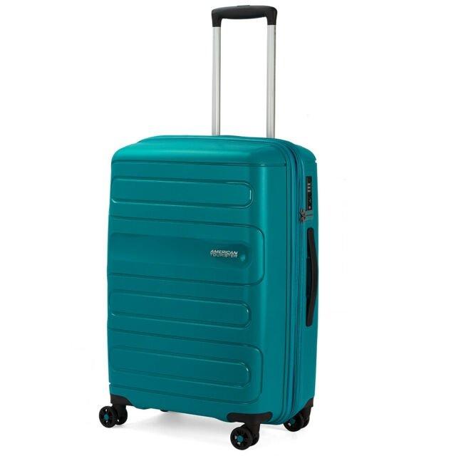 Bagaż podreczny Sunside na czterech obrotowych kołach. Bagaż posiada zamek szyfrowy TSA. 55 cm kabinowy ciemny turkus