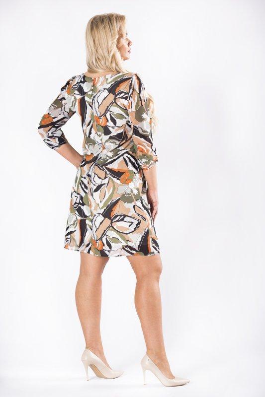 tiulowa sukienka we wzory z rozcięciem na biuście