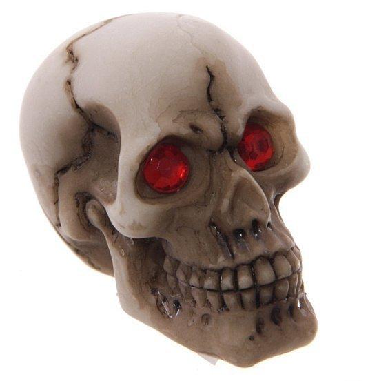 mała figurka dekoracyjna - Czaszka z czerwonymi oczami