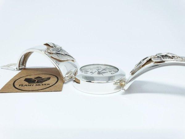 Srebrny zegarek z listkiem kod 911