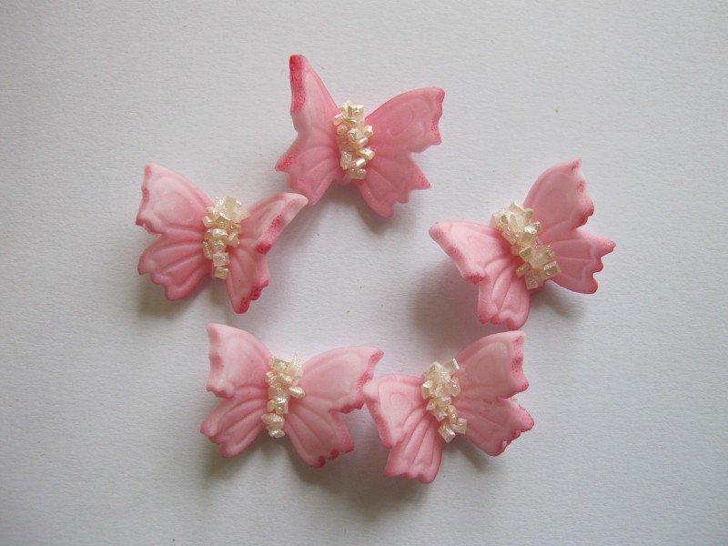 Motylki cukrowe na tort małe różowe 3D 5szt