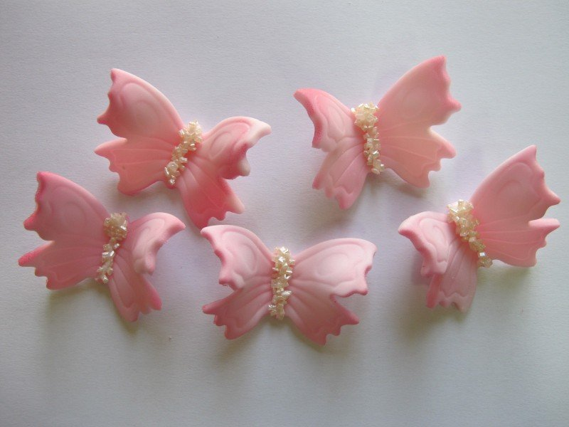 Motylki cukrowe na tort duże różowe 3D 50szt